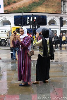 Women taking pictures at Piccadilly Circus. © Violet Acevedo