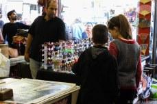 Looking at the knickknacks in the Portobello Market store. © Violet Acevedo