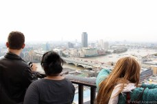 Tourists taking in the cityscape from the Golden Gallery. © Violet Acevedo