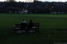University of Edinburgh students relax in The Meadows at dusk. © Violet Acevedo