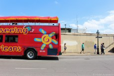 Tourists departing a sightseeing bus behind the French Market. © Violet Acevedo