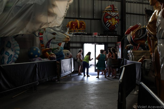 Tourist waiting for the shuttle at the doors of Mardi Gras World. © Violet Acevedo