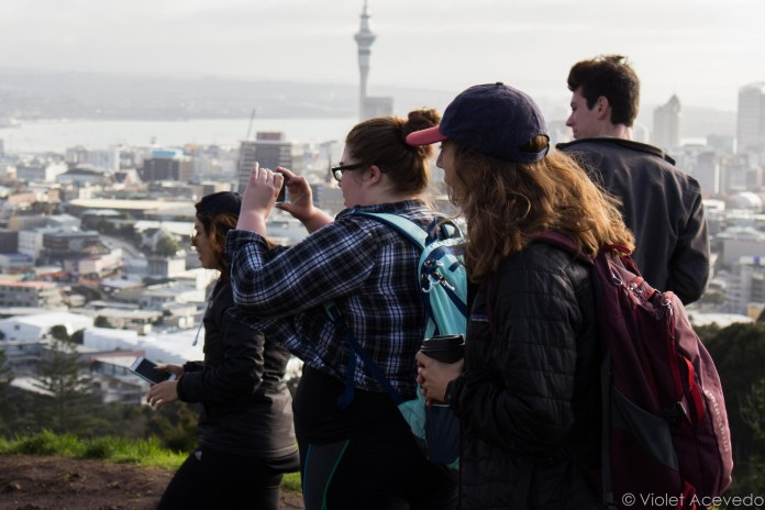 """This is the dream."" Our group gaping at the view on top of Mt. Eden. © Violet Acevedo"
