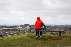 Backpacker taking in the view of residential Auckland. © Violet Acevedo