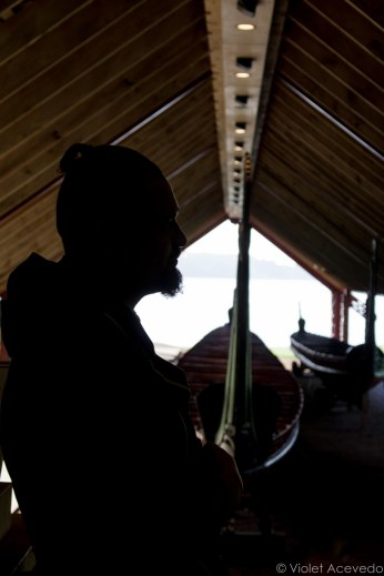 Our Maori guide in front of the wakas at the Waitangi Treaty Grounds. © Violet Acevedo