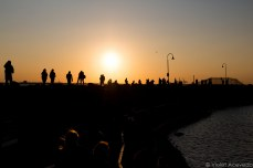 People start to gather near the boardwalk at the end of the pier. © Violet Acevedo