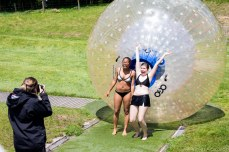 Yvonne and Kirsten posing for another pictures in front of their zorb. © Violet Acevedo