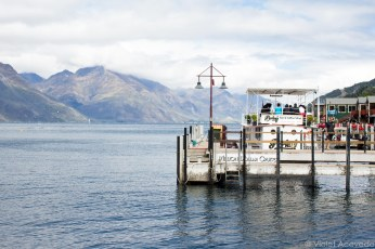 A boat cafe floats on the waters of Lake Wakatipu. © Violet Acevedo