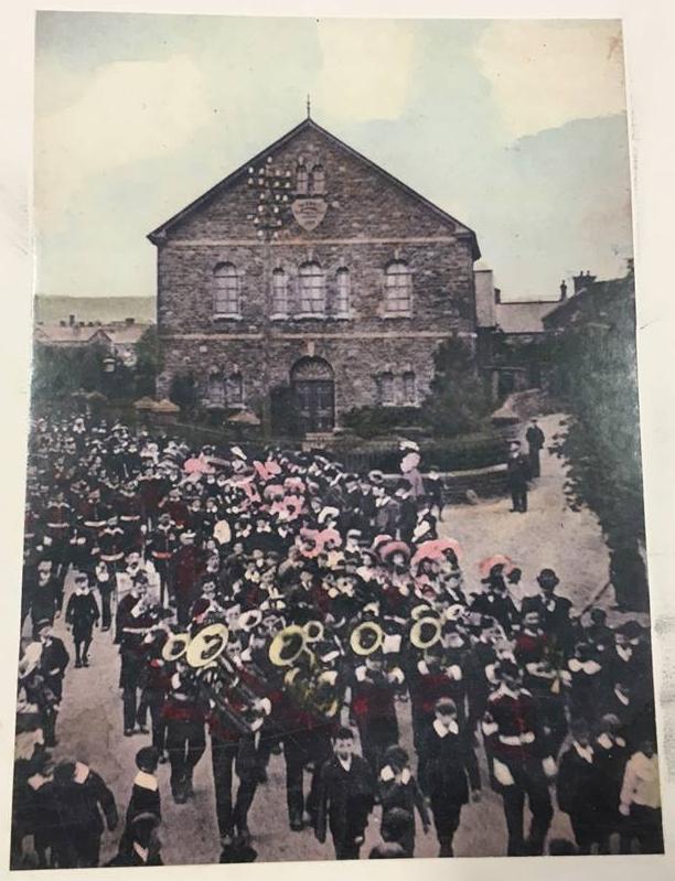 Parade past Hermon Chapel circa 1904