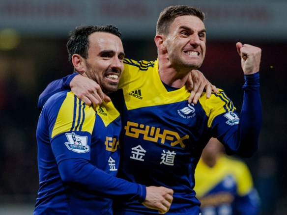 Tuesday 25 March 2014 Pictured: ( L-R ) Leon Britton and Angel Rangel Celebrate Re: Arsenal FC v Swansea City FC, Barclays Premiere league game at the Emirates Stadium, London, UK