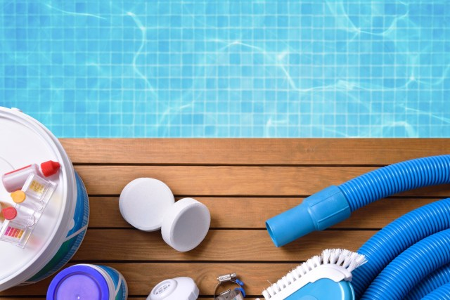 picture of pool cleaning supplies for a Pool Water Chemistry blog post