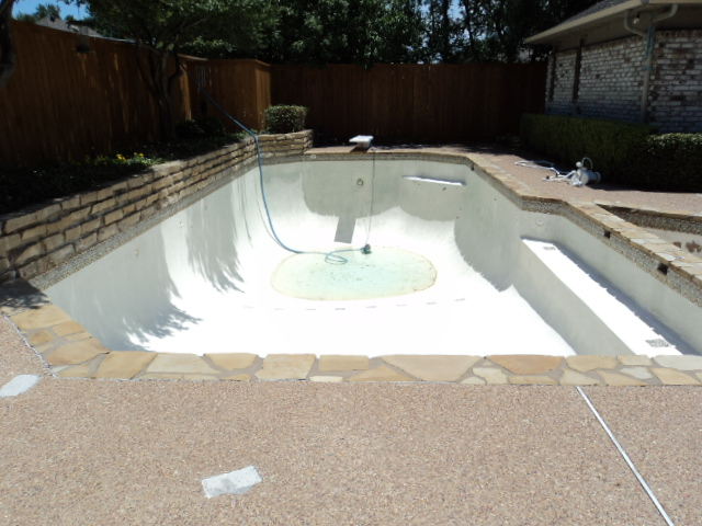 new plaster and tile on an old pool can