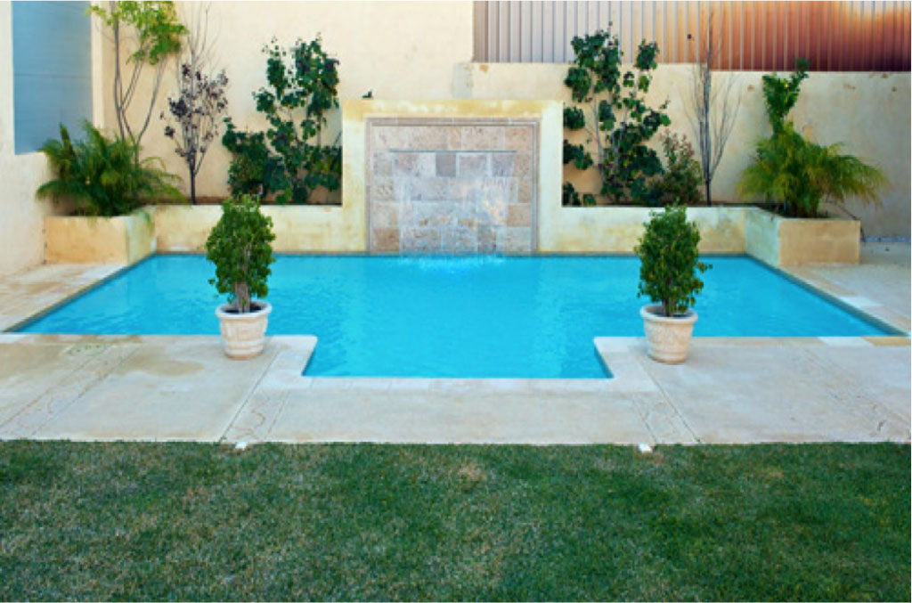 fibreglass pool resurfaced with tiled travertine water feature
