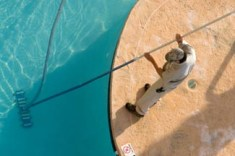 Cleaning pool by vacuuming it - pool maintenance