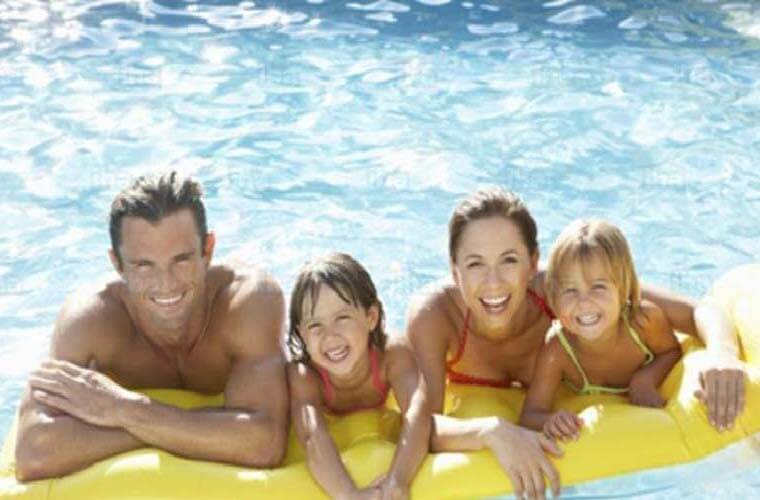 Family in new Inground Pool