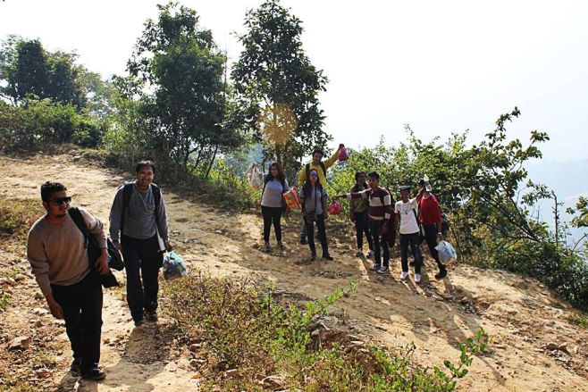 Hikers with polythene bags collected on the way