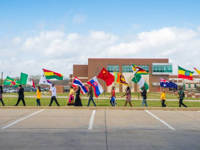 A Multicultural Fest flag ceremony. Photo by Texas A&M University via Flickr [CC BY 2.0].