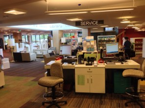The service desk is centrally placed and easily accessible. Librarians don't hide behind walls or counters.