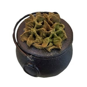 Small plastic cauldron filled with piped bubble bath that is an olive green and brown color. It is piped to look like bubbles you'd see in a bubbling cauldron.