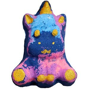 Sitting chubby unicorn shaped bath bomb. It is made of swirls consisting of dark blue, light blue, purple, and light pink. There is golden glitter throughout the blue as well as pastel like sprinkles. The horn, inner ears, and four feet have shimmery golden hooves painted on, as well as golden eyes and smile.