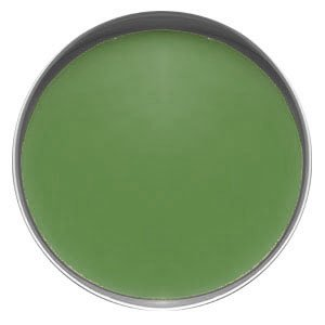 Top view of a round silver tin filled with a smooth green lotion bar.
