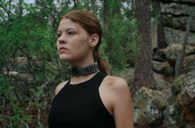Katie Burgess as Joy in The Jurassic Games