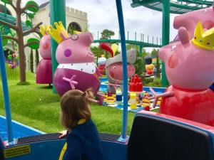 Twins at Peppa Pig World on the new rides