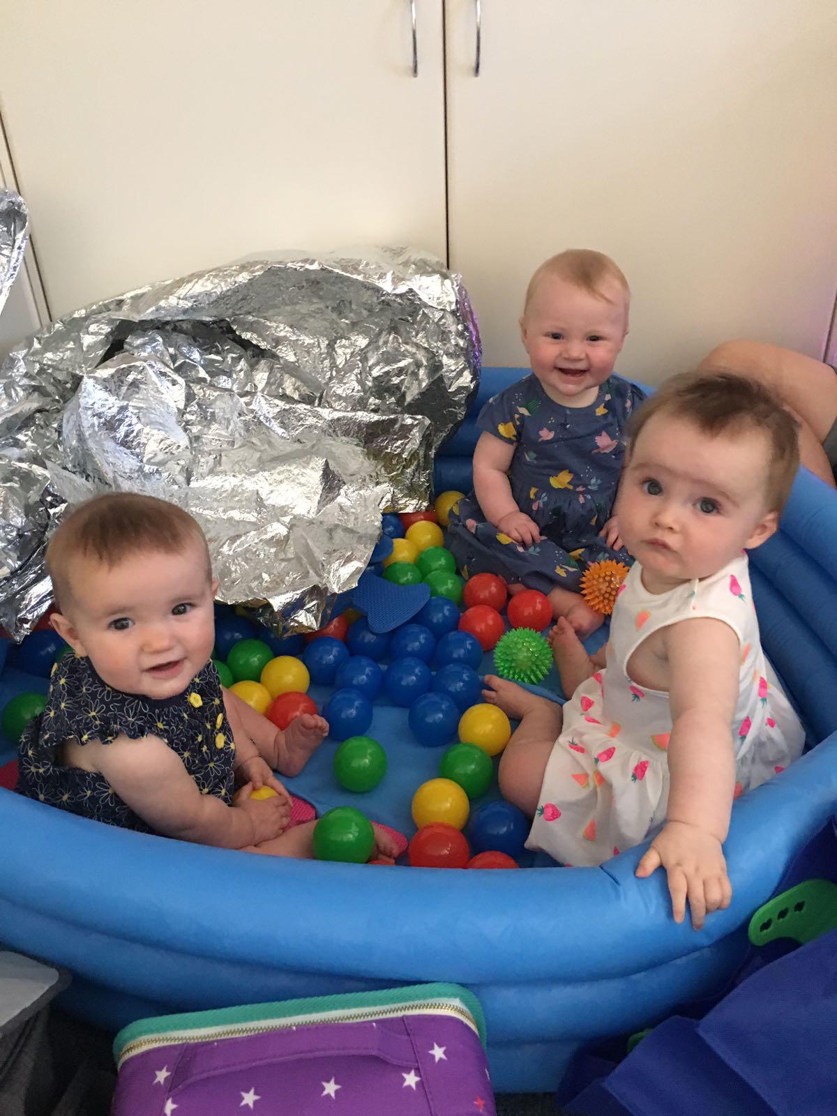 Children playing at baby massage