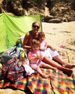 beach in Cornwall with twins playing on the sand