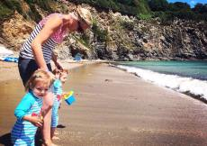 Twins on a beach. Preparing your baby for jet lag