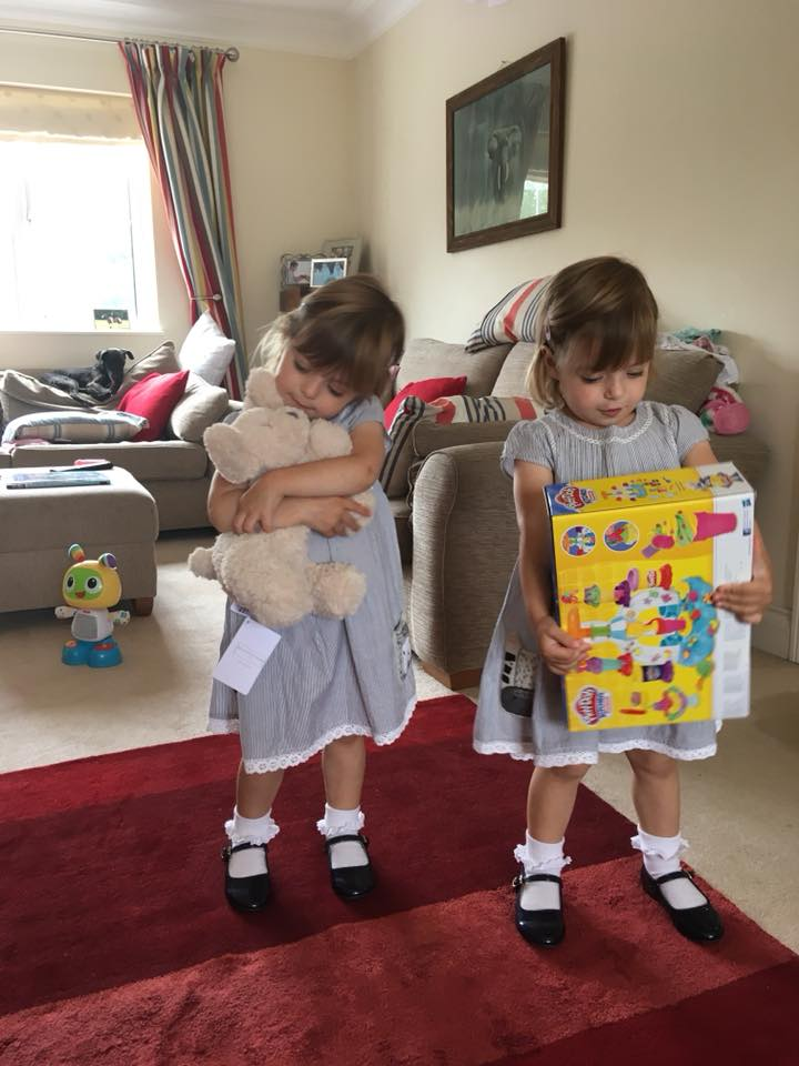 twins opening their birthday presents