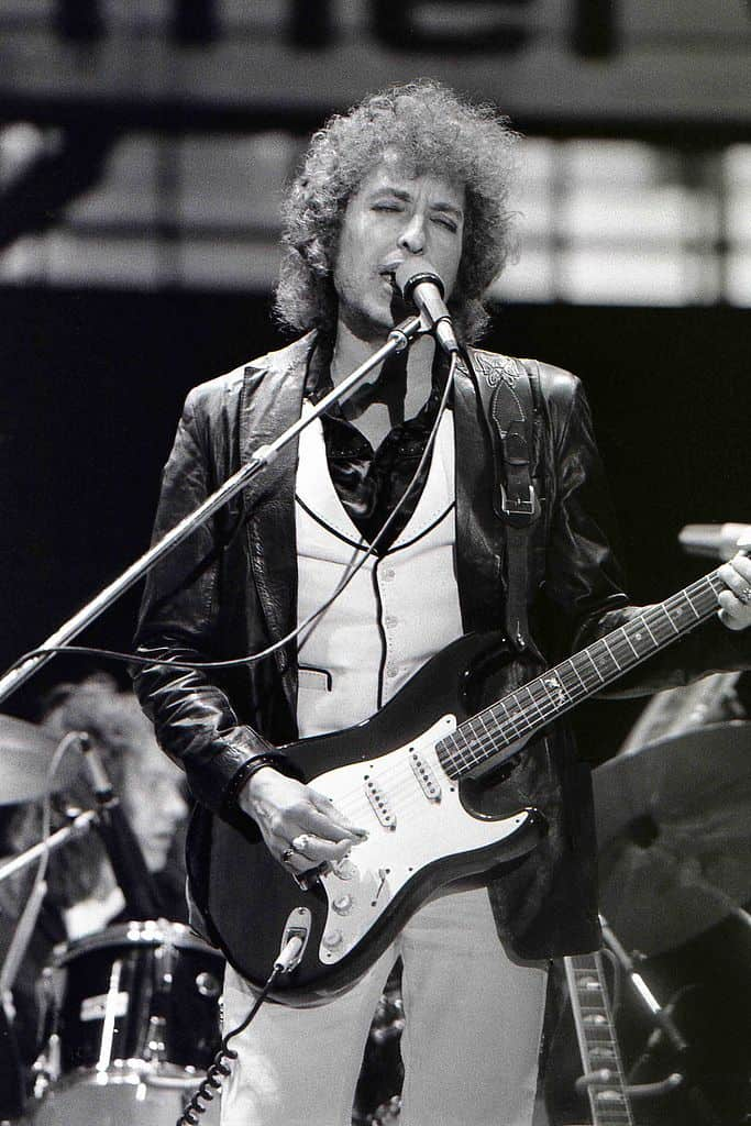 "Chris Hakkens, <a href=""https://commons.wikimedia.org/wiki/File:Bob_Dylan_June_23_1978.jpg"">Bob Dylan June 23 1978</a>, <a href=""https://creativecommons.org/licenses/by-sa/2.0/legalcode"">CC BY-SA 2.0</a>"