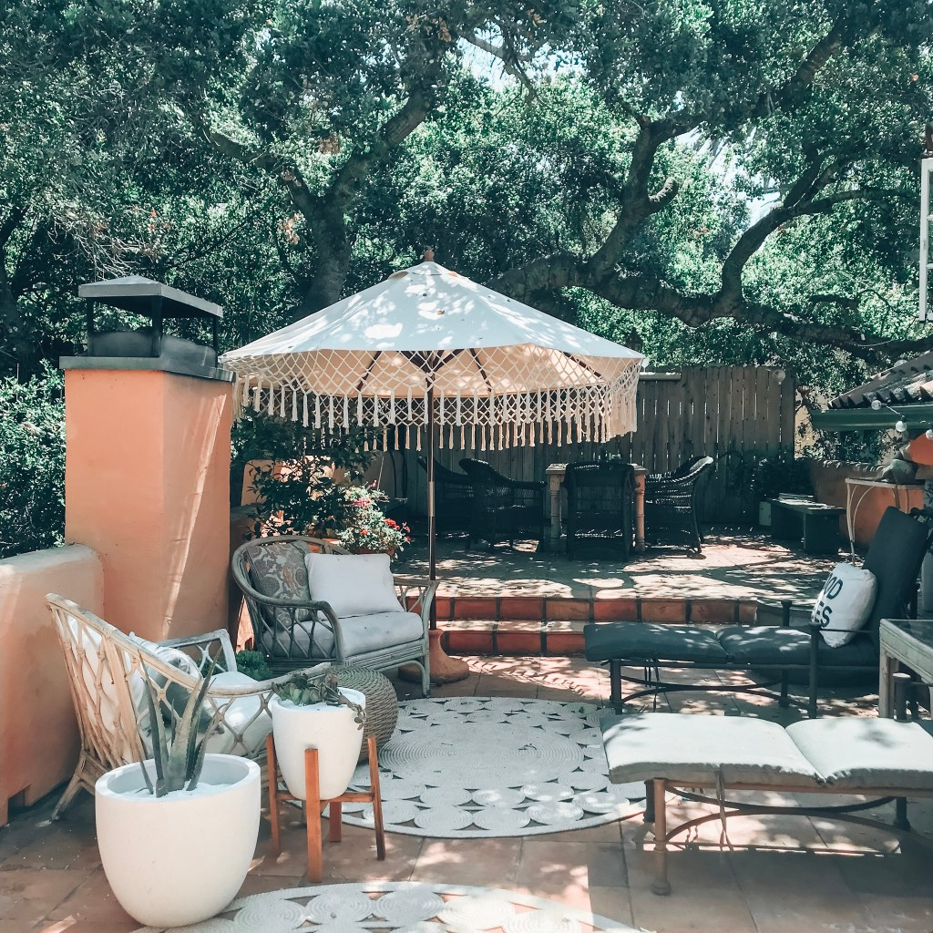 boho outdoor decor | vintage furniture | rattan furniture | modern planters | macrame umbrella World Market | deck design | patio ideas | Poplolly co