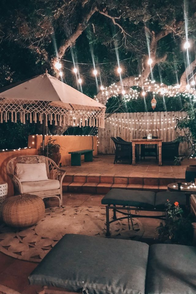 Boho outdoor decor at night with twinkle lights | Poplolly co