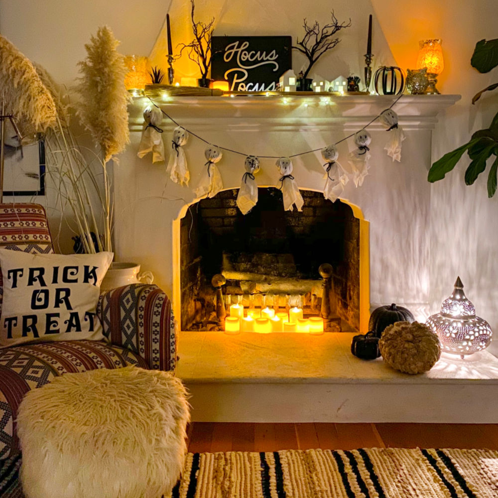 Halloween fireplace decorating ideas with candles, DIY ghost bunting garland and Hocus Pocus sign | Halloween at Home |#halloweendecorations #halloweendecorationsindoors #halloweendecorationsdiy | Poplolly co