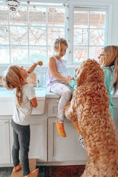 kids hanging in the kitchen with goldendoodle | Poplolly co