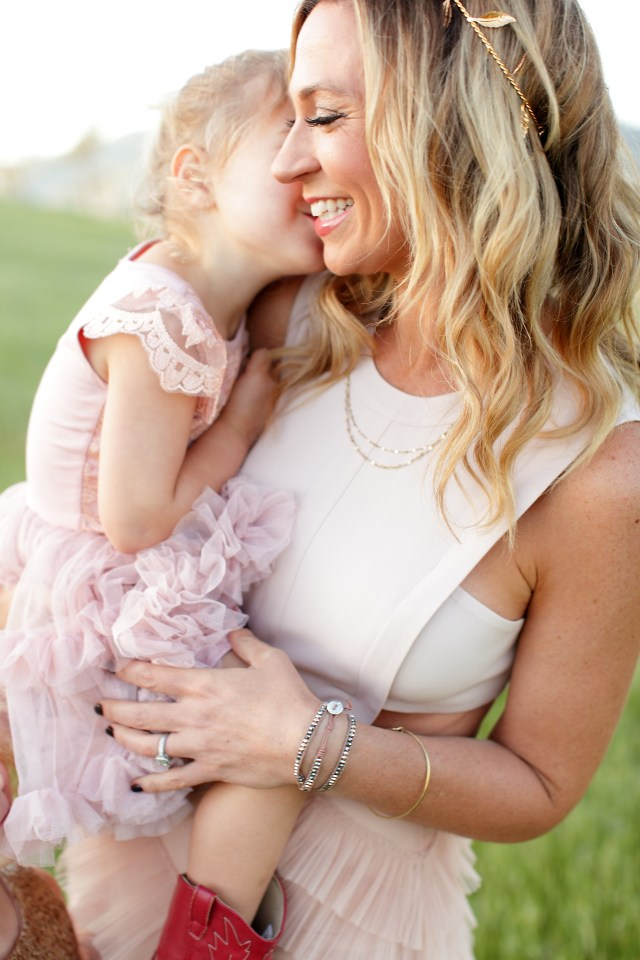 mother in pink dress cuddling her daughter | mother daughter spa day at home gift guide | Poplolly co