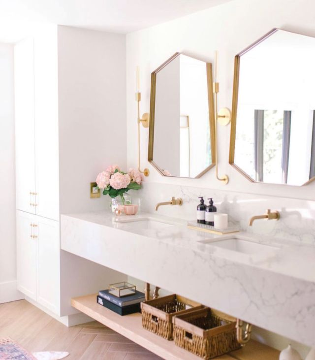modern bathroom with brass mirrors, marble counters and white oak chevron floors | Poplolly co
