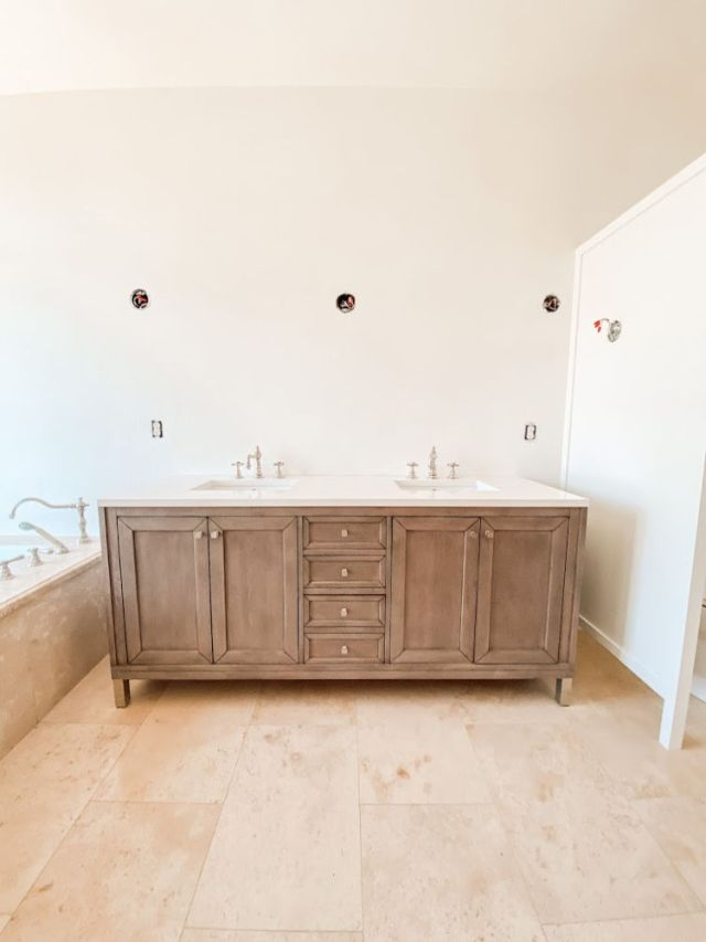 modern white washed walnut vanity in a travertine tile bathroom | Poplolly co