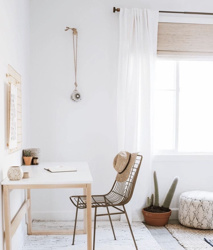 bright white home office corner with ceramic bell | Poplolly co