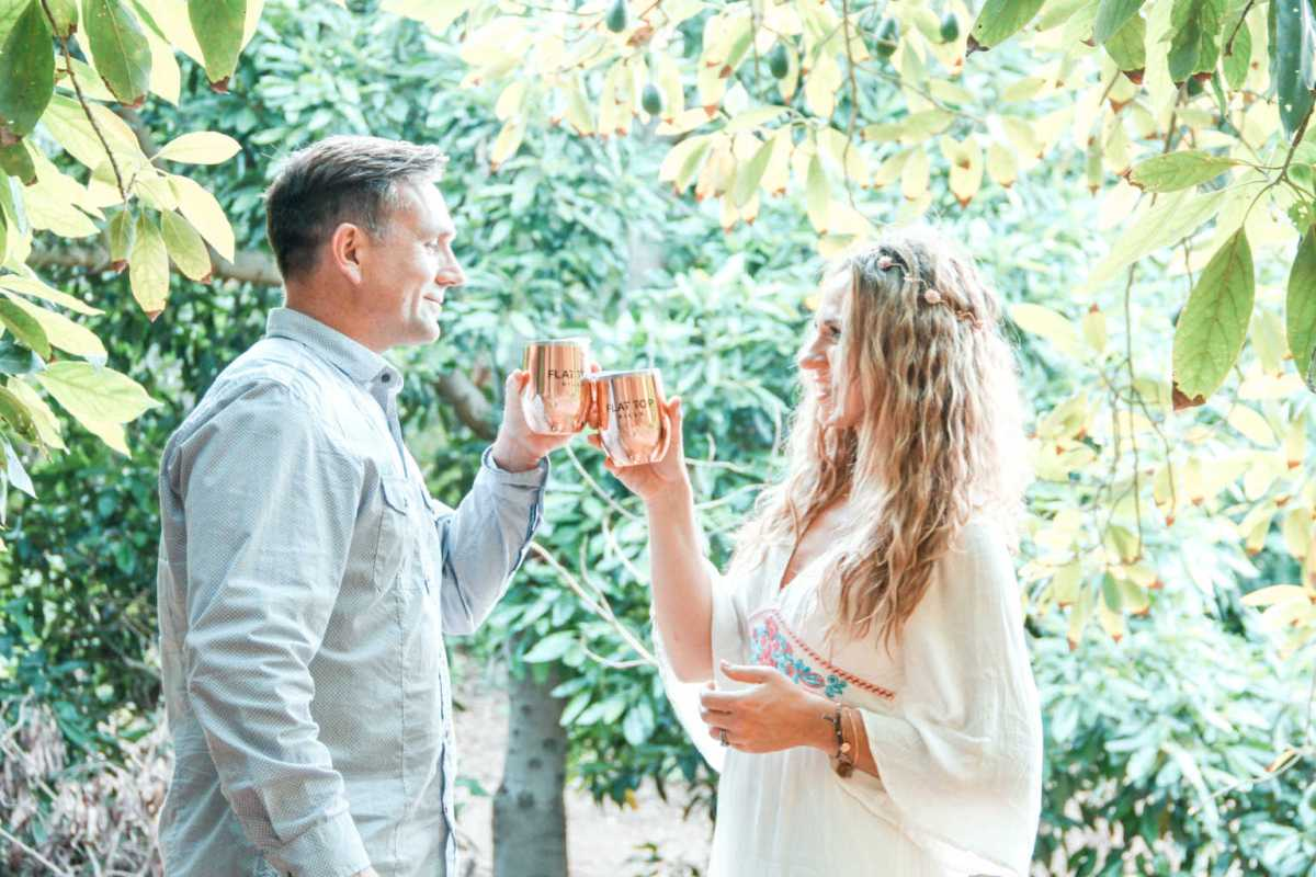 toasting with flat top wines in our avocado orchard | Poplolly co