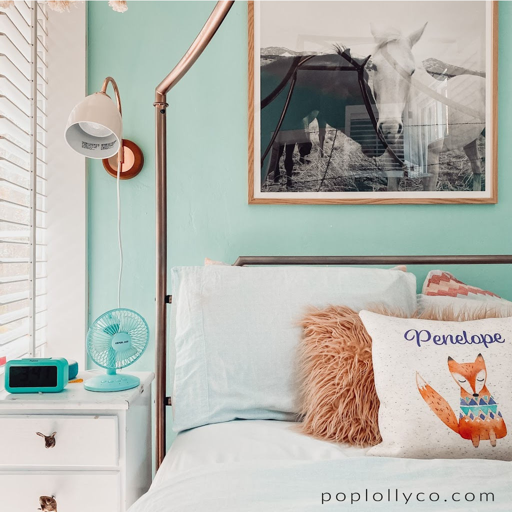 boho girls bedroom with rose gold canopy bed and horse picture | #kidrooms #kidspaces #girlsroomideas #tweengirlsroom | Poplolly co