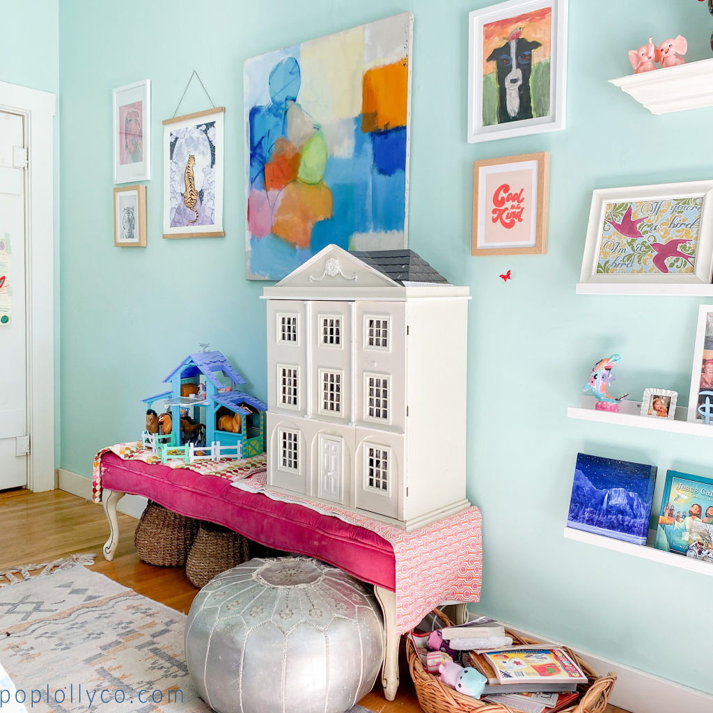 tween bedroom with fuschia vintage bench, vintage dollhouse, silver pouf, and colorful art on turquoise walls | Poplolly co
