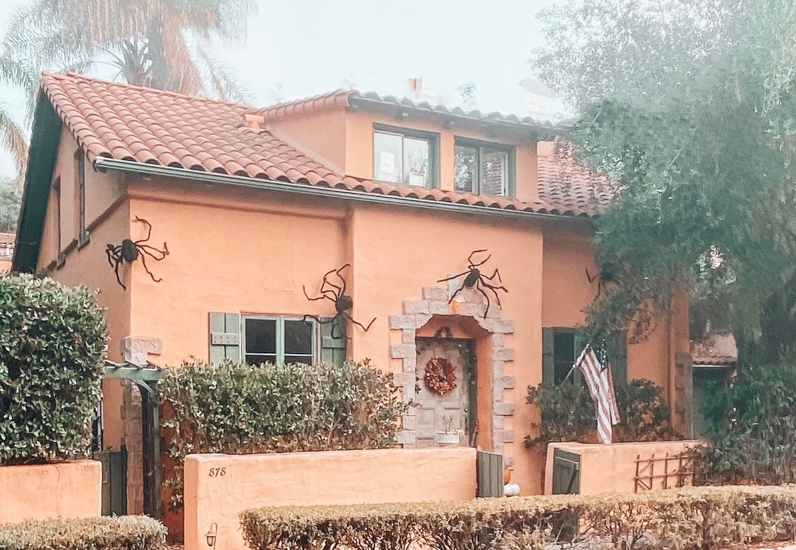 Spanish home with giant spiders for Halloween | #halloweendecorationsoutdoor #halloweenhouse #halloweenporch #halloweenyarddecorations | Poplolly co
