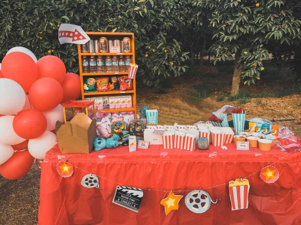 DIY concession stand and decorations for a backyard movie birthday party | Poplolly co