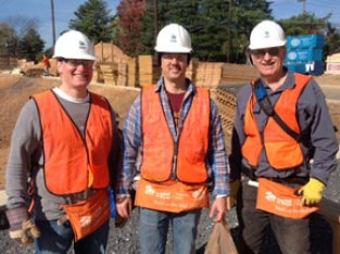 Three Prince of Peace volunteers with Habitat for Humanity