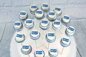 NCLH cake pops corporate company logo