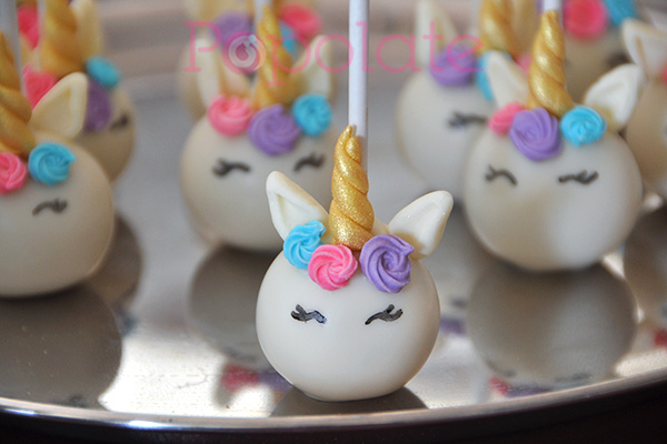 Purple and pink unicorns cake pops