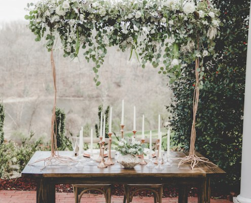 Hanging greenery centerpiece with copper accents