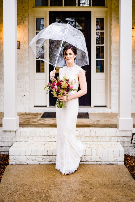 bride with a clear umbrella and her bouquet